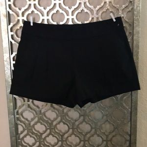 Classic black shorts with side zipper & pockets